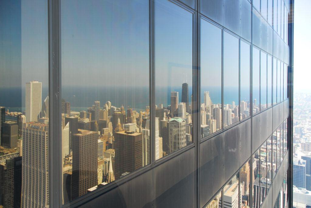 City skyline reflection in windows