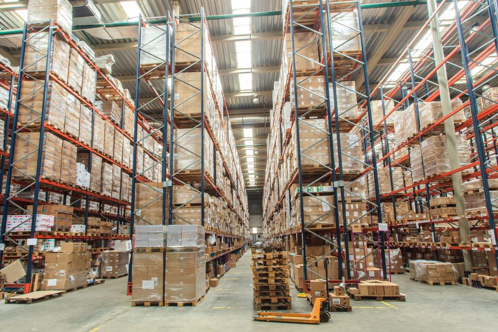 warehouse shelves stocked with boxes